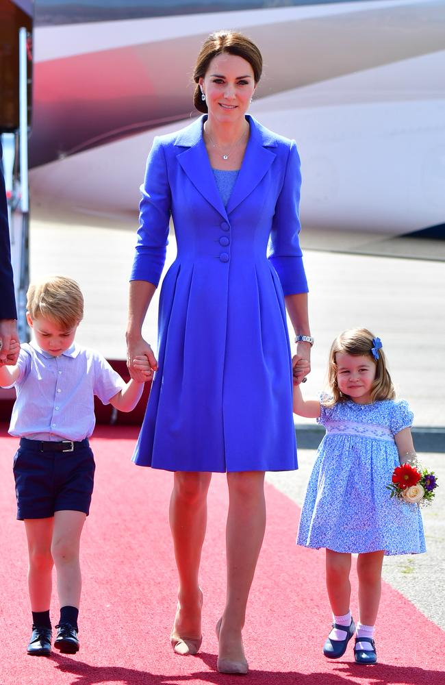 Seeing triple? The Duchess of Cambridge, alone with Prince George and Princess Charlotte, all wore blue at Berlin Tegel Airport. Picture: Getty Images