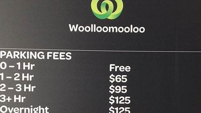 The price board outside Woolworths Woolloomooloo carpark in Sydney.