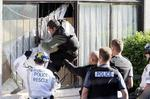 <p>7th April 2009...... Police break into the Taren Point clubhouse of the Rebels bikie gang just one of several locations targeted by police today. Photo: Troy Bendeich</p>