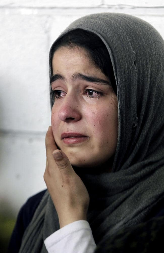 A Syrian refugee girl weeps during the visit of United Nations High Commissioner for Refugees (UNHCR) Antonio Guterres to Khaldeh, south of Beirut, Lebanon. Picture: AP