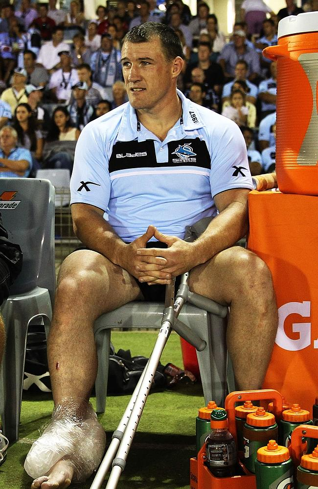 Paul Gallen after injuring his ankle in round one against the Titans. Pic Brett Costello