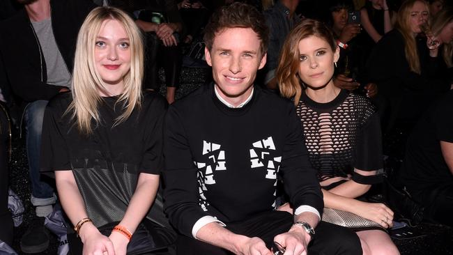 (L-R) Actors Dakota Fanning, Eddie Redmayne, Kate Mara attend the Alexander Wang X H&M Launch on October 16, 2014 in New York City. (Photo by Andrew H. Walker/Getty Images for H&M)