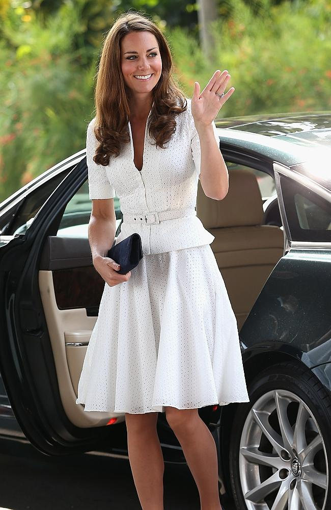The Duchess is a vision in a white mid-knee number. Would the Queen approve? Picture: Getty