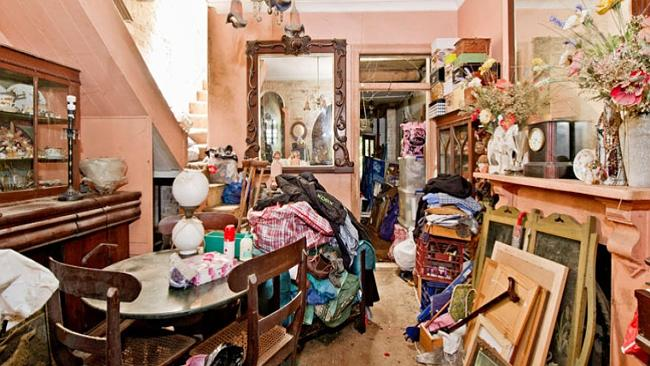 This hoarder's home in Darlinghurst sold for $1.05 million recently despite its rundown condition.