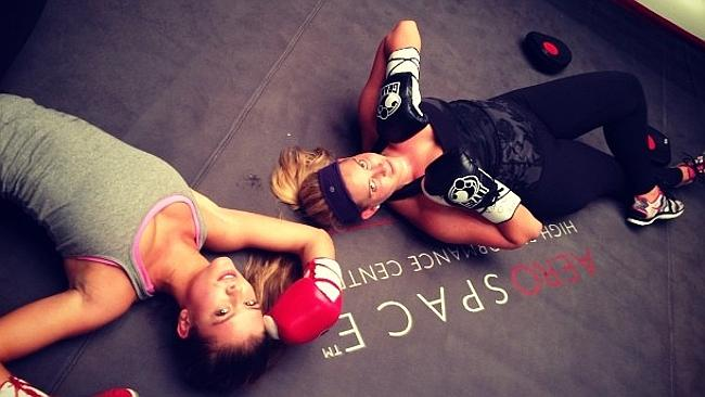 Knock out ... Nina relaxes after a boxing session with a friend in NYC. Picture: Instagra