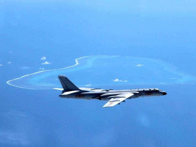 A Chinese H-6K bomber patrols the islands and reefs in the South China Sea. Picture: AP