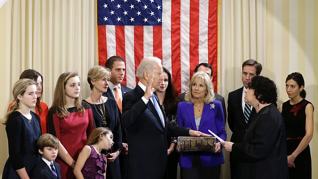 Vice President Joe Biden, with his wife Jill Biden holding the Biden Family Bible, takes the official oath of office from Supreme Court Justice Sonia Sotomayor, surrounded by family, during an official ceremony at the Naval Observatory. Family members from left: Maisy Biden, R. Hunter Biden, Noami Biden, Finnegan Biden, Natalie Biden, Kathleen Biden, Hunter Biden, Ashley Biden, Howard Krein, Beau Biden, Hallie Biden.