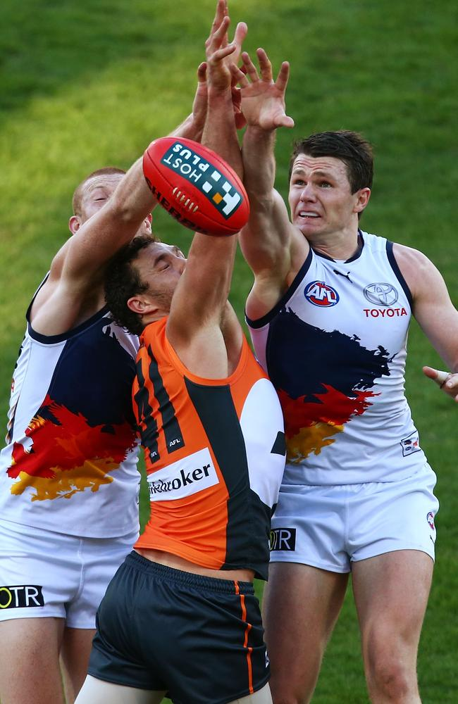 Adelaide Crows Sam Jacobs and Patrick Dangerfield compete with Giant Patrick Dangerfield. Picture: Getty