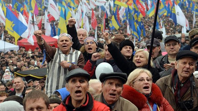 People shout slogans during the rally in Kiev. AFP PHOTO/ SERGEI SUPINSKY