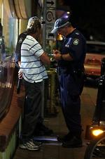 "<p>Police search and talk to a non schoolie after drug sniffer dog ""Doug"" stoped him on the street in Byron Bay.</p>"