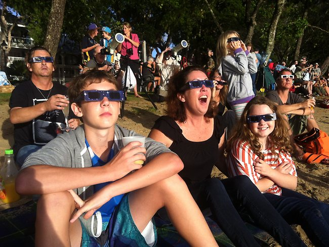 Eclipse FNQ: amazed onlookers watching the eclipse at Palm Cove. Picture: Simon Crerar