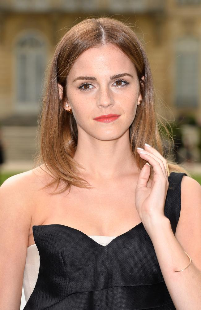 Sleek ... Emma Watson stepped out in an asymmetric, one-shoulder black and white dress