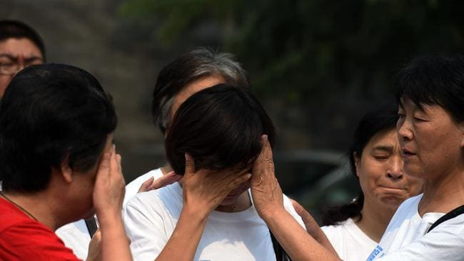 Hope is lost ... relatives of passengers cry as they gather in Beijing.