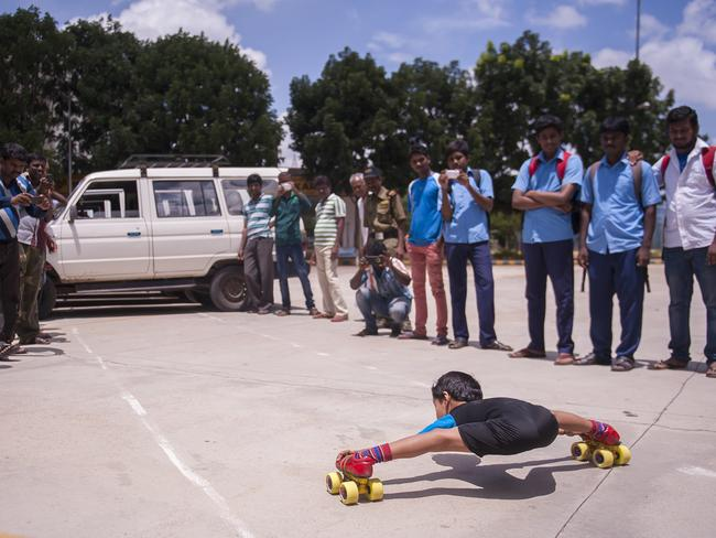"Gagan has plenty of fans in his home town Bangalore. Picture: Barcroft Media / Splash News ""I love skating,"" he said. ""I have been doing it since I was three years old. My next goal is to skate underneath 100 cars. I also want to go to the Olympics."""
