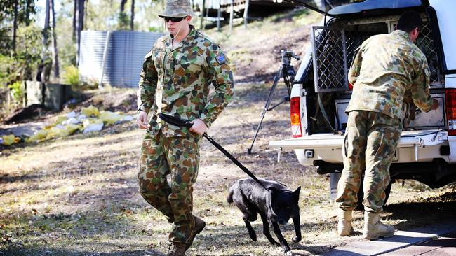The Defence Force checking the property at 117 Red Cedar Road in Pullenvale where bomb making material was found. Pics Tara Croser.