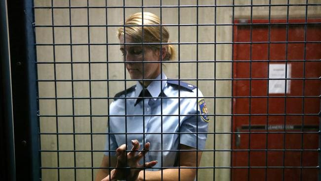 A policewoman at the Surry Hills police station holding cells from where 18-year-old Amy Sharp allegedly escaped while being held on stealing charges. Picture: Adam Taylor