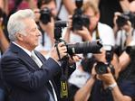 "Actor Dustin Hoffman takes a picture as he attends the ""The Meyerowitz Stories"" photocall during the 70th annual Cannes Film Festival at Palais des Festivals on May 21, 2017 in Cannes, France. Picture: Getty"