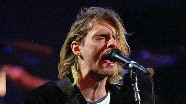 FILE - This Dec. 13, 1993 file photo shows Kurt Cobain of the Seattle band Nirvana performing in Seattle, Wash. Two decades after Nirvana frontman Kurt Cobain killed himself in Seattle, fans flocked to his home to pay homage to the influential rocker Saturday April 5, 2014. (AP Photo/Robert Sorbo, File)