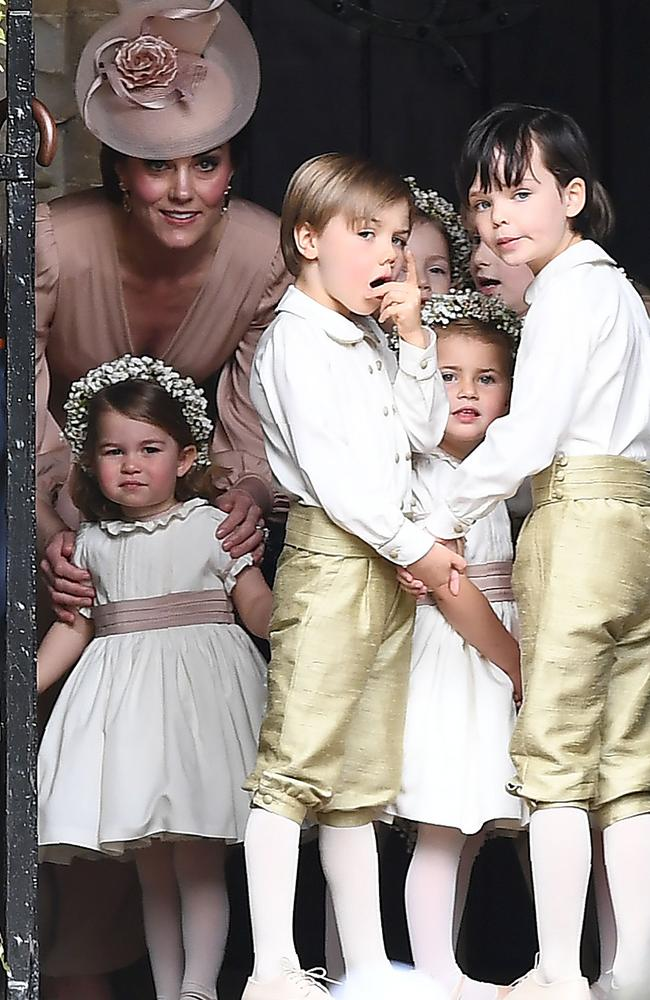 Prince George was also a pageboy at Pippa Middleton's wedding, while Princess Charlotte can be seen with her mum. Picture: AFP PHOTO / POOL AND AFP PHOTO / Justin TALLIS