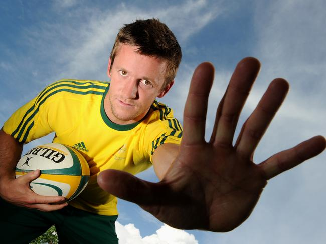 A sevens rugby player helpfully demonstrates the number of players on a team. He only missed by two.