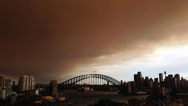 Harmful effect ... Sydney's CBD is shrouded in a haze of smoke from bushfires in Springwood, Winmalee and Lithgow in the Blue Mountains last October. Picture: Getty