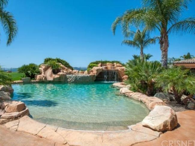 The resort-style pool comes with a waterfall. Picture: Zillow.com.