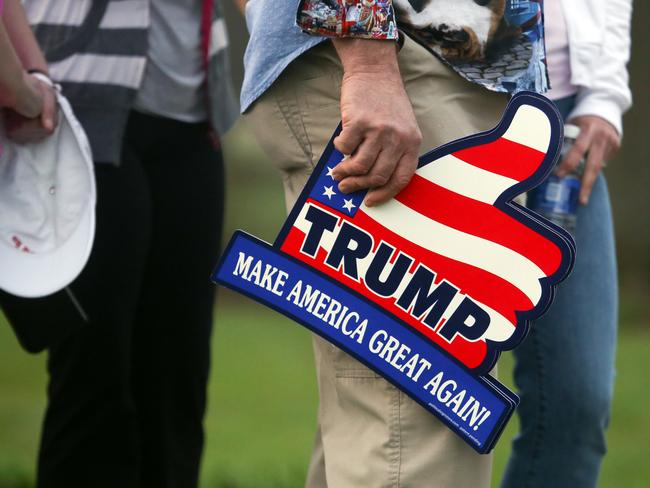 A Donald Trump supporter holds a Trump sign during a recent rally. Picture: AP