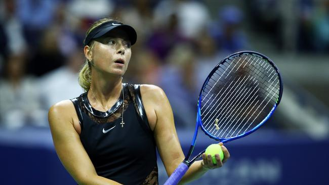 Maria Sharapova of Russia serves during her first round Women's Singles match against Simona Halep. Picture: Getty