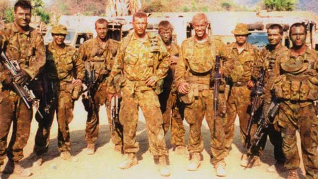 Discharged ... Former soldier Paul Golle (centre) and comrades in East Timor in 2001. Picture: supplied.