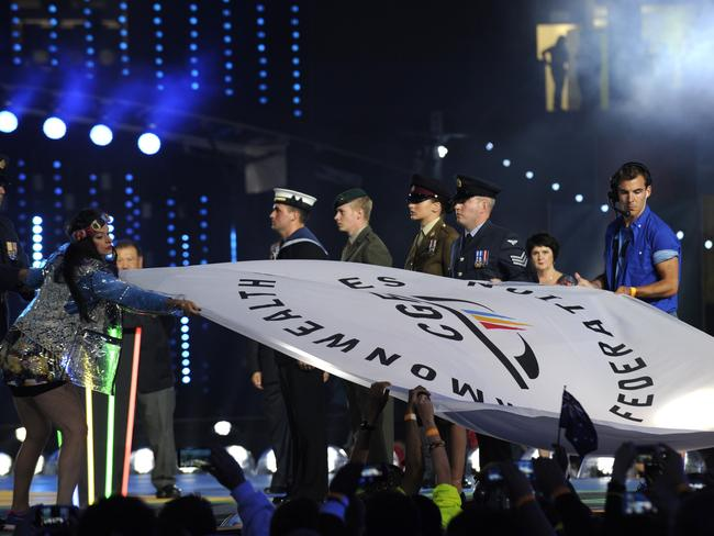 The Commonwealth Games Federation flag is brought onto the stage for the handover during the closing ceremony of the 2014 Commonwealth Games in Glasgow / Picture: AFP