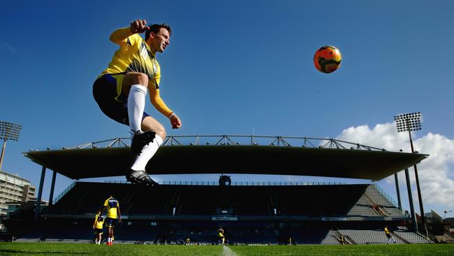 Alessandro Del Piero leaps high to get control of the ball during a training session.