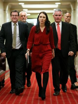 Prime Minister-elect Jacinda Ardern, with Grant Robertson and Kelvin Davis, arrives at Parliament in Wellington.