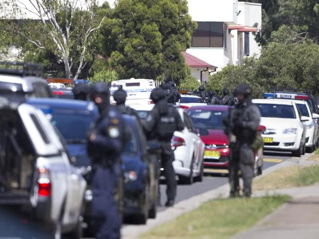 Heavily armed police outside the industrial complex today. Picture: Melvyn Knipe