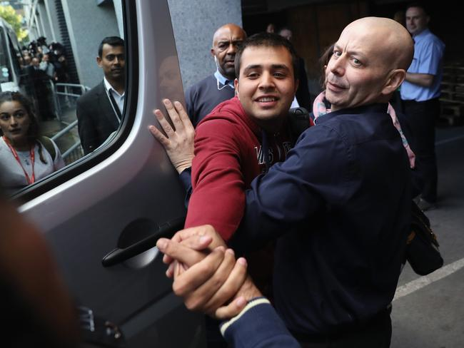 Jan Ghazi greets his nephew Haris. Picture: Dan Kitwood/Getty Images