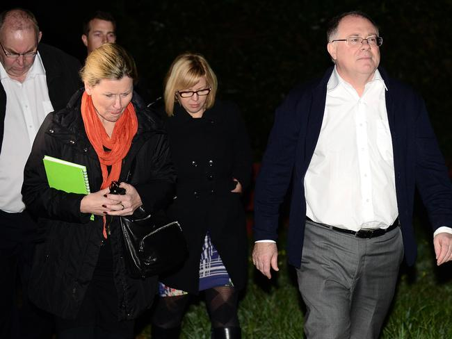 Environment Minister Ian Hunter walks up Ash Ave in Clovelly Park with other door-knockers to inform residents they will have to move. Picture: Tom Huntley