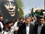 <p>Iranian parliament speaker Ali Larijani, center, attends a protest after the Friday prayer  while a worshiper holds up a poster of US President Barack Obama, as part of widespread anger across the Muslim world about a film ridiculing Islam's Prophet Muhammad. Picture: AP</p>