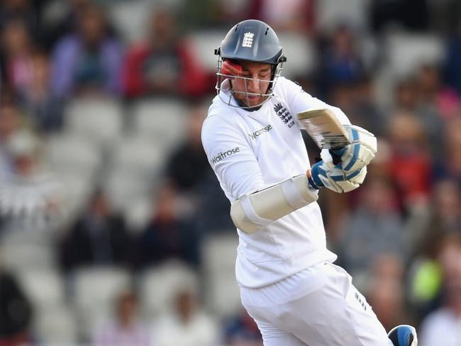 Stuart Broad cops a ball to the face through the grill of his helmet.
