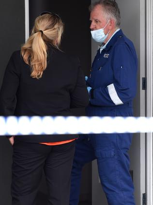 A detective speaks to Forensic Police searching a Sunshine North property following a firearms incident. Picture: Nicole Garmston.