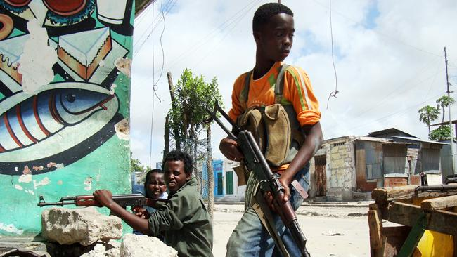 Hard-line ... Islamist teenage fighters man a checkpoint at a road in the vicinity of the presidential palace in Mogadishu, on May 14, 2009. Photo: AFP.