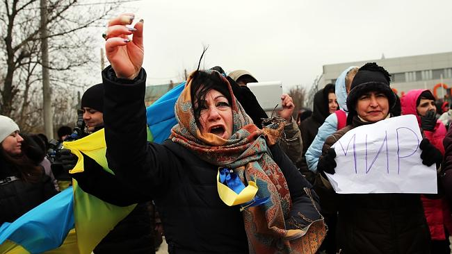 Not giving up yet ... Supporters of Ukraine yell at pro- Russian protesters during a rally in support of the keeping Crimea a part of the Ukraine in Simferopol, Ukraine.