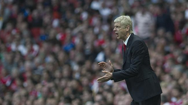 Arsenal's manager Arsene Wenger shouts instructions from the sidelines.