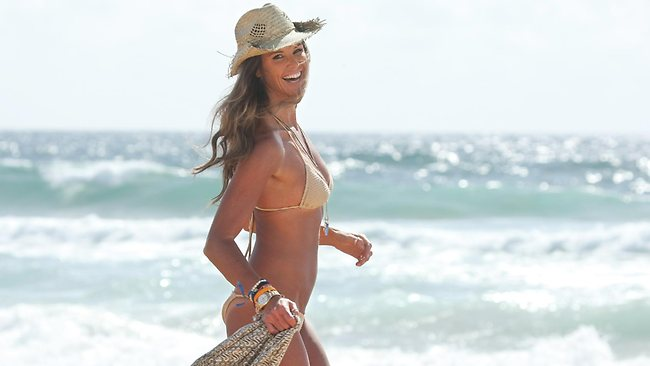 Model Elle Macpherson was still appearing in a bikini for a TV commercial well into her 40s. Picture: Anthony Reginato