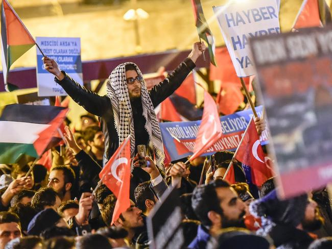 Protesters wave Palestinian and Turkish flags in Istanbul. Picture: AFP PHOTO / YASIN AKGUL