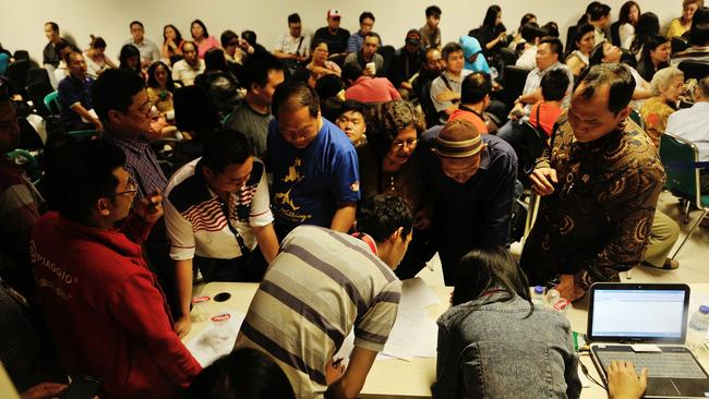 Relatives of missing Air Asia QZ8501 passengers gather during a meeting with officials at the crisis centre of Juanda International Airport Surabaya on December 28. Picture: Robertus Pudyanto