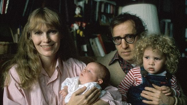 Family feud... Mia Farrow holding son Ronan, alongside Woody Allen, who is holding daughter Dylan. Picture: David Mcgough/Getty Images