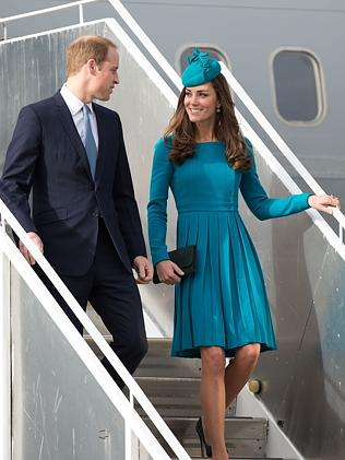 Britain's Prince William with Catherine, the Duchess of Cambridge, walk from the plane af