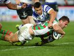 South Sydney's Sam Burgess scores a try during the NRL game between the Canterbury Bankstown Bulldogs and the South Sydney Rabbitohs at ANZ Stadium. Picture Gregg Porteous