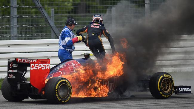 Kvyat bails out of his burning Toro Rosso.