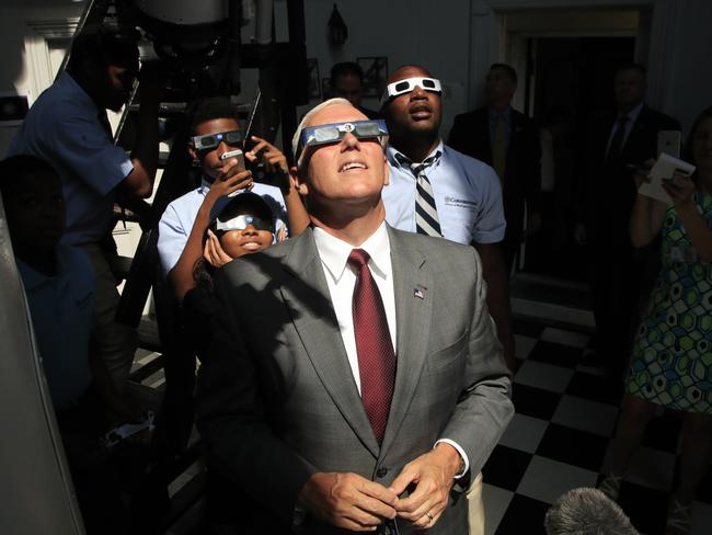 Vice President Mike Pence, with students from Cornerstone Schools, watches the solar eclipse. Picture:AP