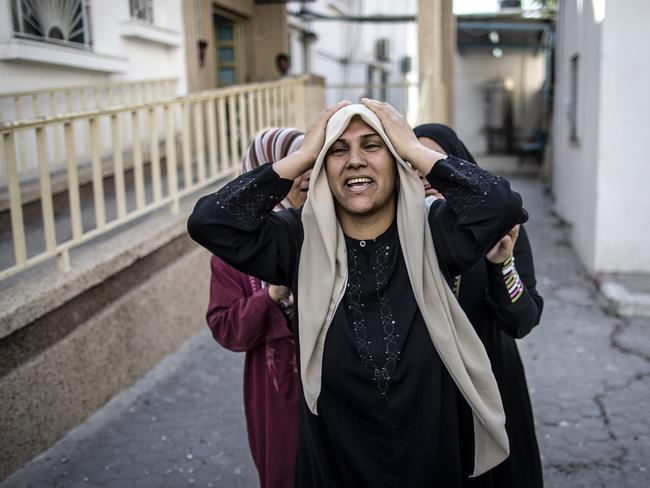 Blood price ... A Palestinian woman reacts to the news of the death of a relative, outside the hospital in the northern district of Beit Hanun in the Gaza Strip.